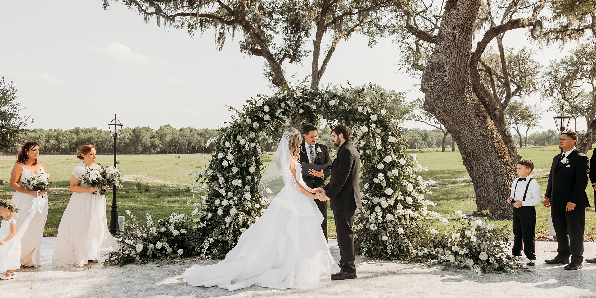 Photo of a Wedding Ceremony Under the Oaks