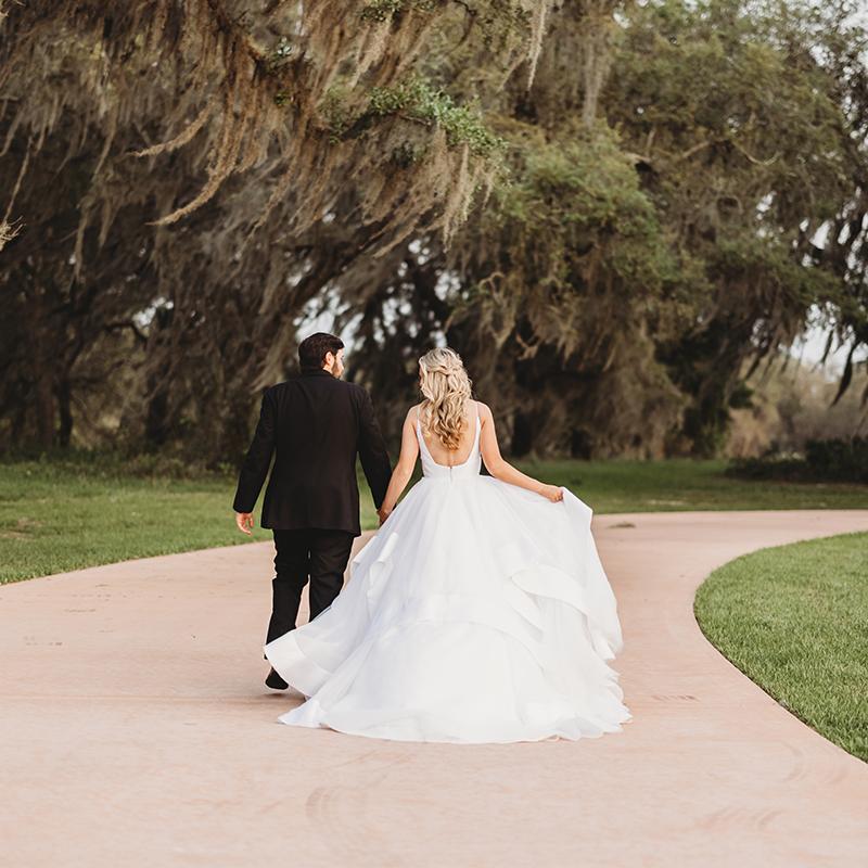 Bride and Groom Walking Under the Oaks